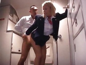 AMWF - Blonde Stewardess Servicing Japanese Passenger
