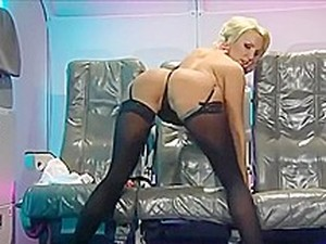 English Blonde Dressed As A Stewardess Does An Awesome Striptease