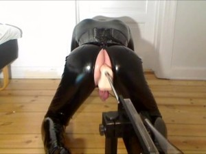 Sissy Crossdresser In Shiny Catsuit And Boots Anal Fucked By Sex Machine