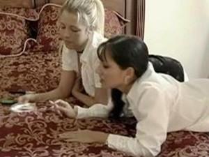 Two Smoking Girls Enjoy Doggy