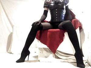 Kinky Crossdresser Encased In Nylon And Sexy Boots