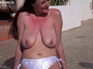 Busty Milf Babe Sat By The Pool Topless And Looking Really Sexy