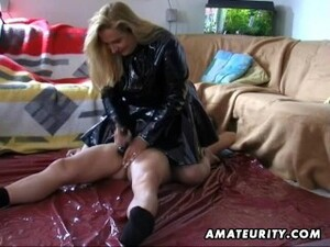Lady In PVC Giving A Bizarre Handjob With Condom