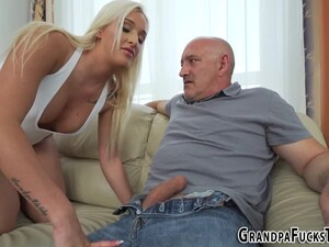 Teenager Blowing Grandpa