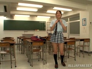 Japanese Hottie Enjoys Sucking A Cock In A Classroom