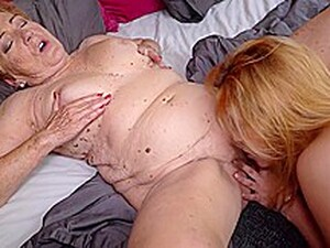 Aroused Granny Is Squeezing Her Tits While A Frisky Lesbian Is Eagerly Eating Her Pussy