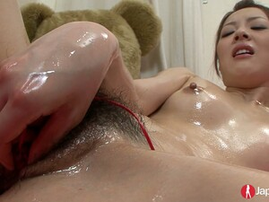 Japanese Chick Hitomi Usami Oils Up Her Pussy And Rubs Her Perky Clit With Fingers