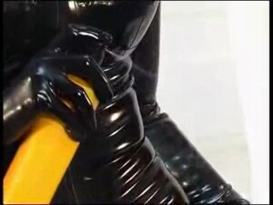 Beautiful Blonde Gets Dressed In Latex Catsuit And Gas Mask