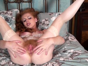 Adorable Redhead Chick Tia Jones Drops Her White Panties To Play