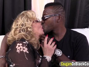 Mature Blonde Tart Is Eager To Take That Huge Cock And Suck It Before Spreading Her Legs For This Handsome Black Lad On The Couch