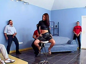Leather-clad Brunette With A Fabulous Body Enjoying A Hardcore Gangbang