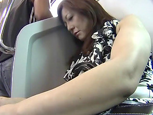 Mature Japanese Woman Being Fondled On The Train Ride