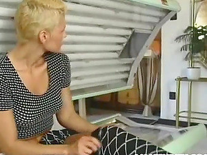 Busty Short-haired Blond Milf Enjoys Sex In A Solarium