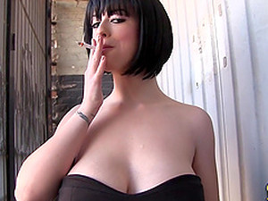 Hot Short Haired Brunette Backstage Having A Quick Smoke