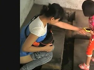 Chinese Ladies In An Old Public Toilet