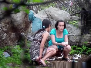 Two Brunette Women Spied Pissing Outdoors