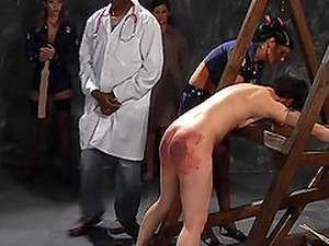 Awesome Hottie Screams Loudly While A Mistress Spanks Her Ass