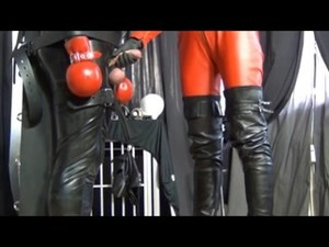 Latex Mistress Dressed In Bondage Leather Does Handjob