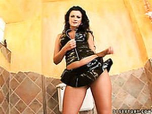 Voracious Brunette In Leather Suit Juditta Masturbates In The Toilet