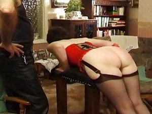 Spanked In Red Corset