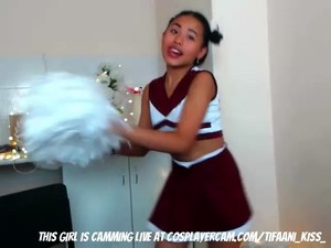 Young Cheerleader Asian....