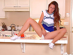 Sexy Cheerleader Bridget Bond Rubbing Her Pussy In Kitchen