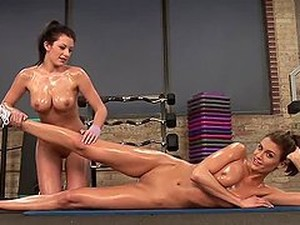 Two Cute Chicks Oil Their Bodies And Have Some Fun In A Gym