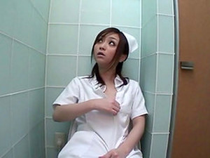 Nurse Sneaks Into The Bathroom To Masturbate With A Vibrator