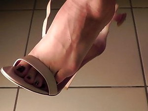 Shoeplay,  Dangling, In High-heel Sandals. Close-up.