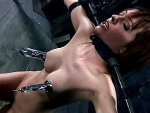 Babe In Latex Suit Gets Punished