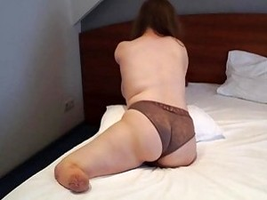 Chubby One-armed Brunette Amputee Puts Her Underwear On All Alone