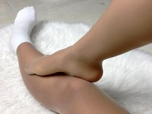 White Sock Over Tan Nylon And Band-aid On The Bunion