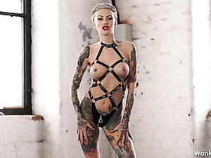 Femdom Humiliation From A Babe Covered In Tattoos
