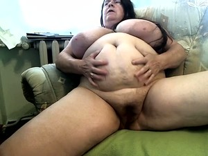 Mature Ugly As Shit Brunette Fatso Plays With Her Enormous Boobies