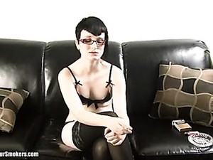 Pale Short Haired Goth Babe With Glasses Having A Smoke