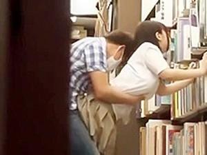 2117315 - School Girls In Books Shop