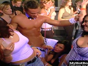 These Cute Ladies Are Gathering Around The Stage To See The Hard Bodied Strippers