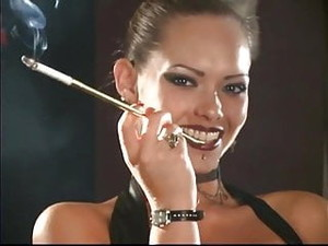 Sexy Leather Mistress Smoking With Holders