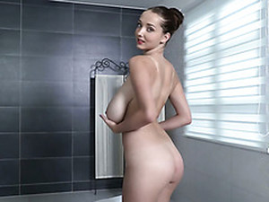 Sexy Dark Haired Chick Plays With Her Extremely Big Jugs When Taking Shower