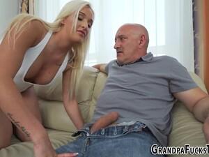 Teenager Blowing Grandpa