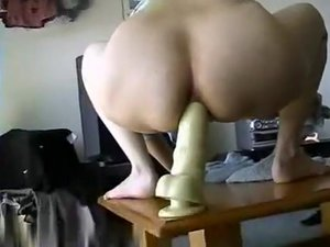 Wild Female And A Huge Dildo