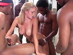 A Very Pretty Blonde Gets Gangbanged By The Black Guys And Enjoys It