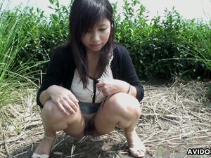 Shameless Asian Chick Karin Asahi Pisses And Shows Off Her Boobies Outdoor