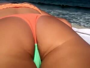 Teen In Bikini Sunbathing In The Concrete