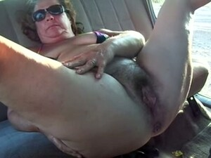 My Fat Old Wife Entertains Herself By Fingering Her Cunt In A Car