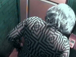 Mature White Lady With Blue Dyed Hair Filmed In The Toilet Room