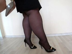 Appetizing Fat Legs In Black Nylon And In Classic Shoes With Heels.