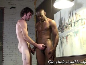 Skinny White Dude Enjoys Stroking And Sucking A Large Black Dick