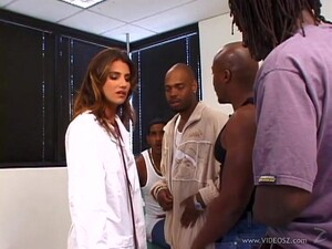 Sexy Doctor Is Blowing Some Huge Black Dicks