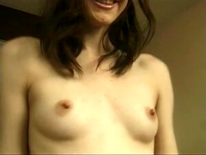 Girl With Perky Nipples Spreads Her Pussy On A Couch